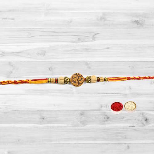 Fashionable Om Embellished Rakhi