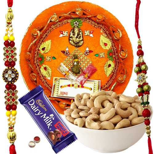Arresting Rakhi Combo Of 2 Rakhi, Rakhi Thali, Cashew N Cadbury Fruit N Nuts