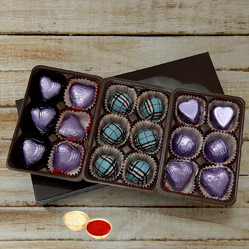 Mouthwatering Pack of 18pcs Assorted Homemade Chocolate. with free Roli Tilak and Chawal.