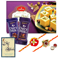 Exquisite Festive Favorite Sweets N Chocolate Gift Hamper with Two Rakhis and Roli Tilak Chawal