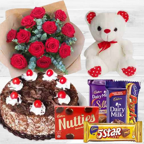 Amazing Bouquet of 12 Dutch Red Roses with 1 Lb Cake, Mixed Cadburys Chocolates and a Teddy Bear