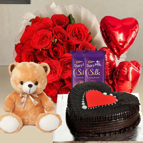 Bright Red Roses, Chocolate Cake, Mylar Balloons, Chocolates and a Teddy