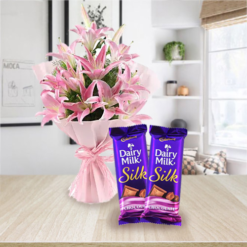 Deliver Combo of Pink Lilies Bouquet and Dairy Milk Silk Online