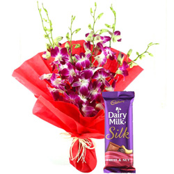 Gift Bouquet of Orchids and Dairy Milk Silk Online