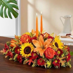 Delightful arrangement of gorgeous Flowers with 2 lovely Candles