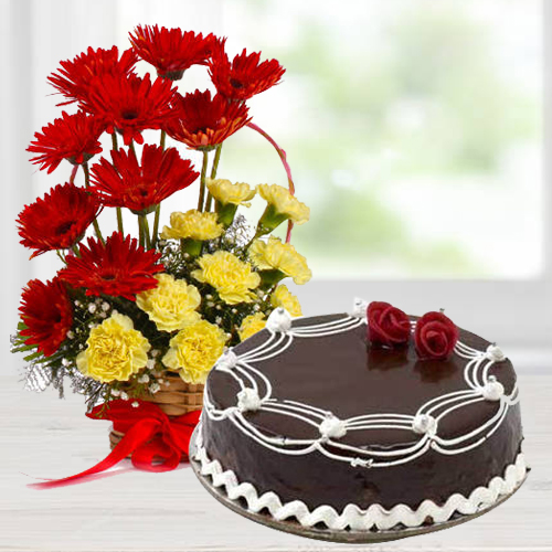Radiant Carnations and Gerberas Arrangement with 1/2 Kg Dark Chocolate Cake