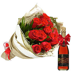 Superb Arrangement of Red Roses and Fruit Juice