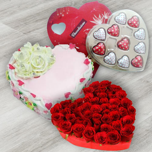 Extraordinary 24 Red Roses, Heart Shaped Chocolate Box and 1 Lb Heart Shaped Cake