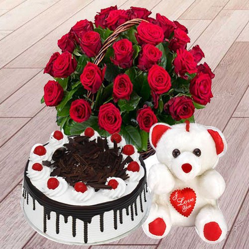 Vibrant 25 Red Roses with 1 Lb Black Forest Cake and a Teddy Bear