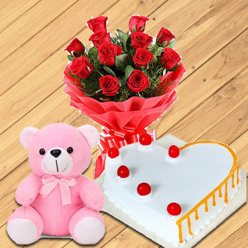 Ideal 12 Dutch Red Roses with Teddy Bear and 1/2 Kg Heart Shaped Cake
