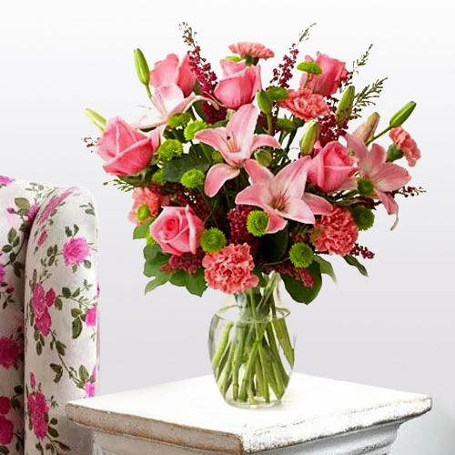 Pretty Arrangement of Lilies, Roses and Carnations with  Pure Passion