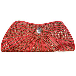 Seek Attention with Orange Clutch along Stone Work