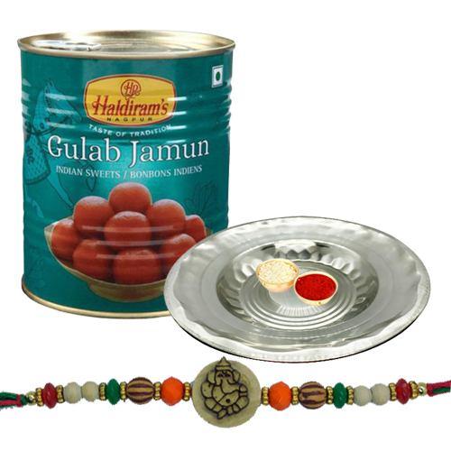Appealing Ganesh Rakhi With Silver Puja Thali And Gulab Jamun
