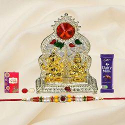 Silver Plated mandap with Golden Ganesh Laxmi Idol with Rakhi and Roli Tilak Chawal