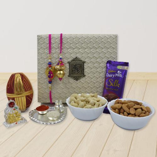 Pious Lumba Rakhi Set with Pooja Items, Dry Fruits n Cadbury Silk
