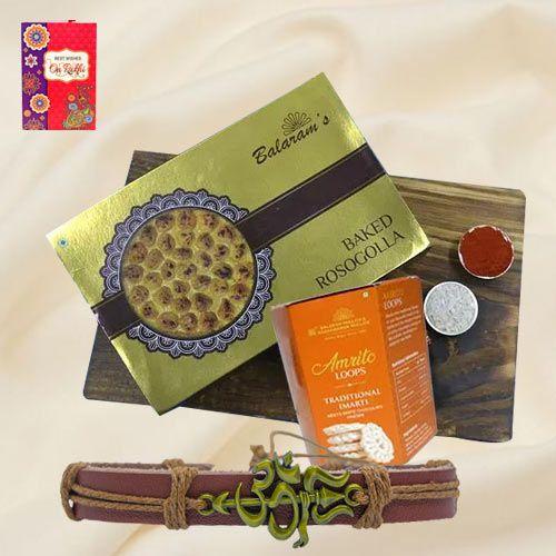 Sumptuous Balaram Mullicks Rasgulla N Chocolate Imarti with Om-Trishul Rakhi