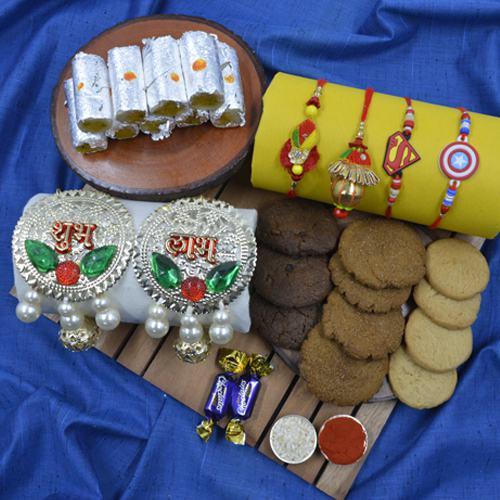 Elegant Family Rakhi Set with Puja Thali, Haldiram Sweets N Cookiemans Cookies