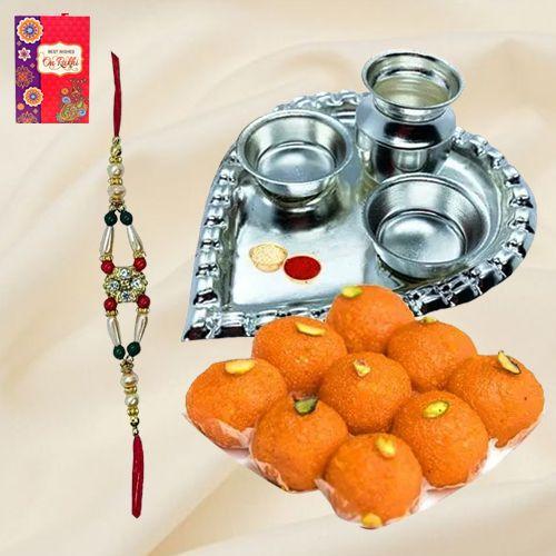 Laddoo and Stylish and Trendy looking Silver Plated Paan Shaped Puja Aarti Thali along Rakhi, Roli, Tilak and Chawal