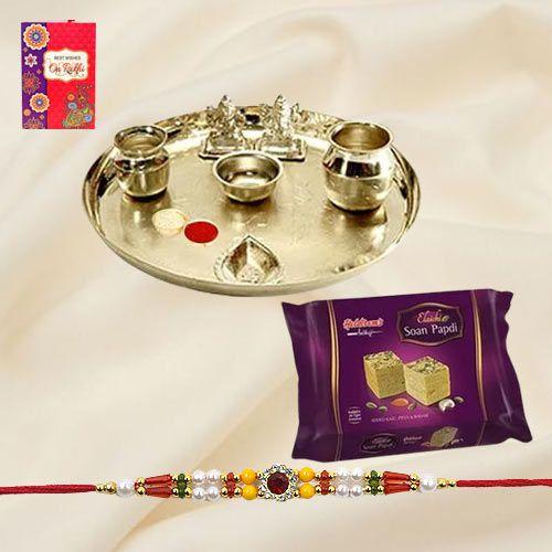 Soan Papri and Stylish and Trendy looking Silver Plated Paan Shaped Puja Aarti Thali along Rakhi, Roli, Tilak and Chawal
