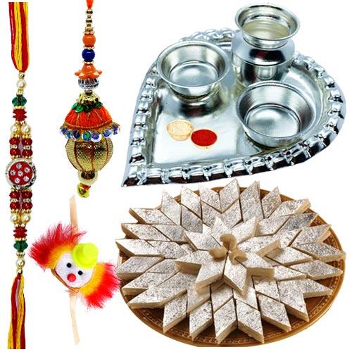 Assorted Sweets and Silver Plated Puja Thali along Rakhi, Roli, Tilak and Chawal