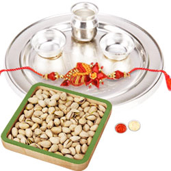 Mind-Blowing Rakhi Selection Gift of One Rakhi with an Ethnic Silver Thali and Salted Pistachio Nuts