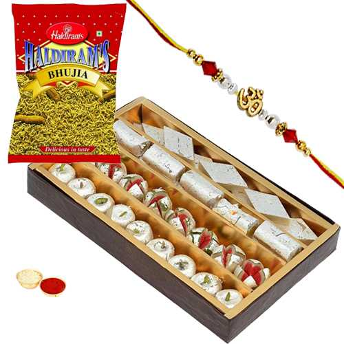 Mouth-watering Assorted Sweets of 500 gm., 200 gm. Haldirams Bhujia and a Rakhi