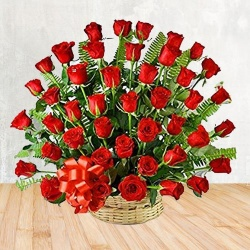 50 Red Roses Arranged in a Basket with Greens , Fillers to show you are there on this auspicious occsion